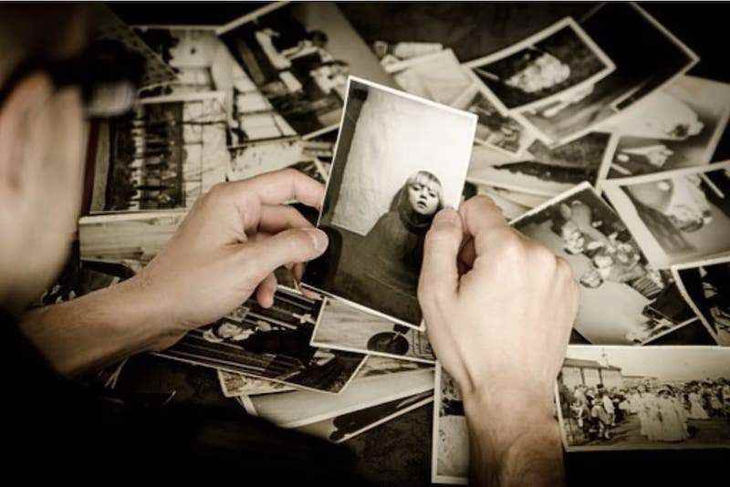 Image of someone looking through old photos